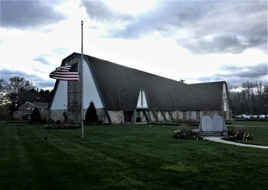 A flag flies at half-staff Thursday evening at a wake for Army Spc. Nicholas DiMona III at St. Mary of the Lakes Church in Medford.