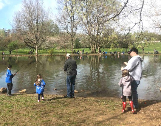 Several people turned out for the annual free Fish with a Firefighter event in Yoctangee Park on Saturday, April 13, 2019.