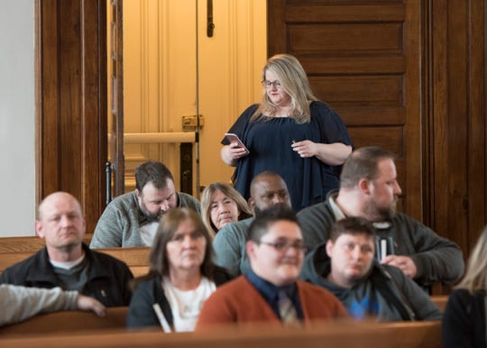 Peer recovery supervisor Tomiah Notestine goes over a list of volunteer activities that participants in Judge Mike Ater's drug court can participate in Monday afternoon.
