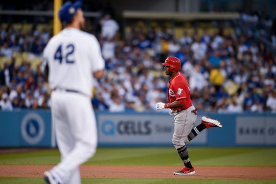 Apr 15, 2019; Los Angeles, CA, USA; Cincinnati Reds right fielder Yasiel Puig (right) rounds the bases after hitting a two-run home run off Los Angeles Dodgers starting pitcher Clayton Kershaw during the first inning at Dodger Stadium. Mandatory Credit: Kelvin Kuo-USA TODAY Sports