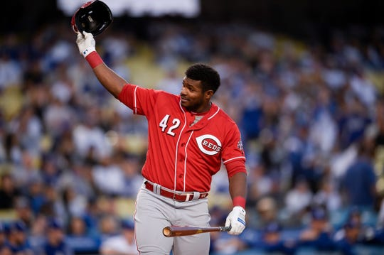 Apr 15, 2019; Los Angeles, CA, USA; Cincinnati Reds right fielder Yasiel Puig waves his helmet to the fans during his at bat during the first inning against the Los Angeles Dodgers at Dodger Stadium. Mandatory Credit: Kelvin Kuo-USA TODAY Sports