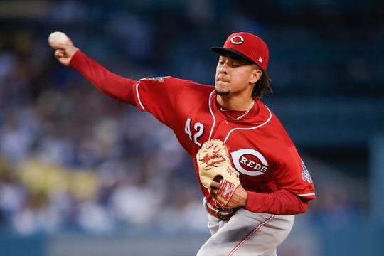 Apr 15, 2019; Los Angeles, CA, USA; Cincinnati Reds starting pitcher Luis Castillo pitches during the first inning against the Los Angeles Dodgers at Dodger Stadium. Mandatory Credit: Kelvin Kuo-USA TODAY Sports