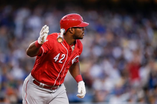 Apr 15, 2019; Los Angeles, CA, USA; Cincinnati Reds right fielder Yasiel Puig throws his bat after hitting a two-run home run during the first inning against the Los Angeles Dodgers at Dodger Stadium. Mandatory Credit: Kelvin Kuo-USA TODAY Sports