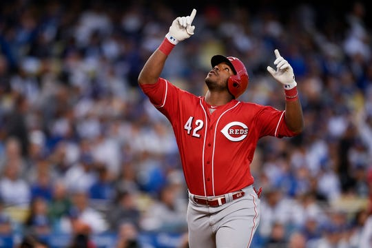 Apr 15, 2019; Los Angeles, CA, USA; Cincinnati Reds right fielder Yasiel Puig reacts while crossing home after hitting a two-run home run during the first inning against the Los Angeles Dodgers at Dodger Stadium. Mandatory Credit: Kelvin Kuo-USA TODAY Sports