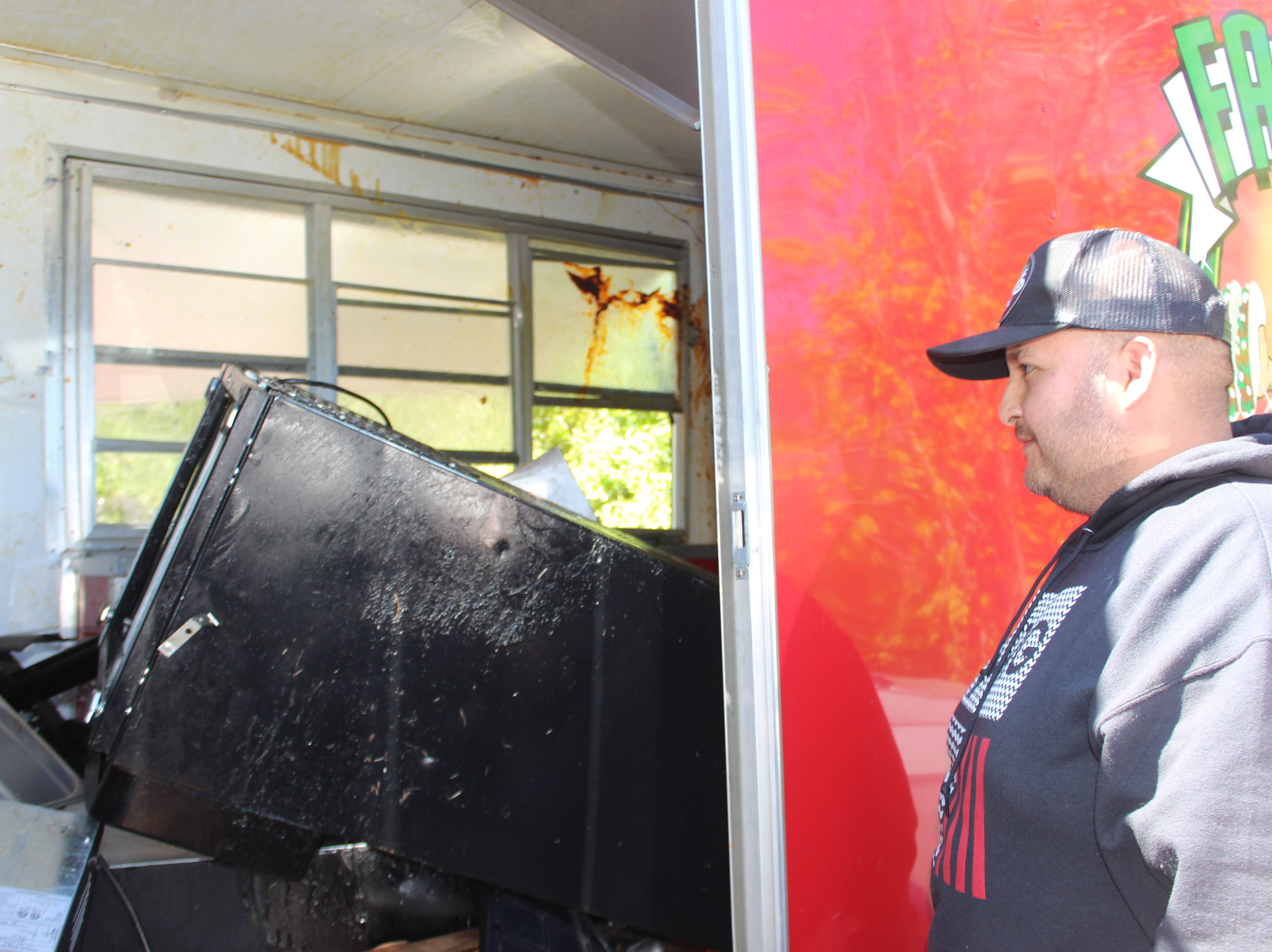 Adrian Gonzalez of Clarksville inspects the damage to his Fatboy Taco trailer, after it was totaled in an accident the night of Saturday, April 13, 2019.