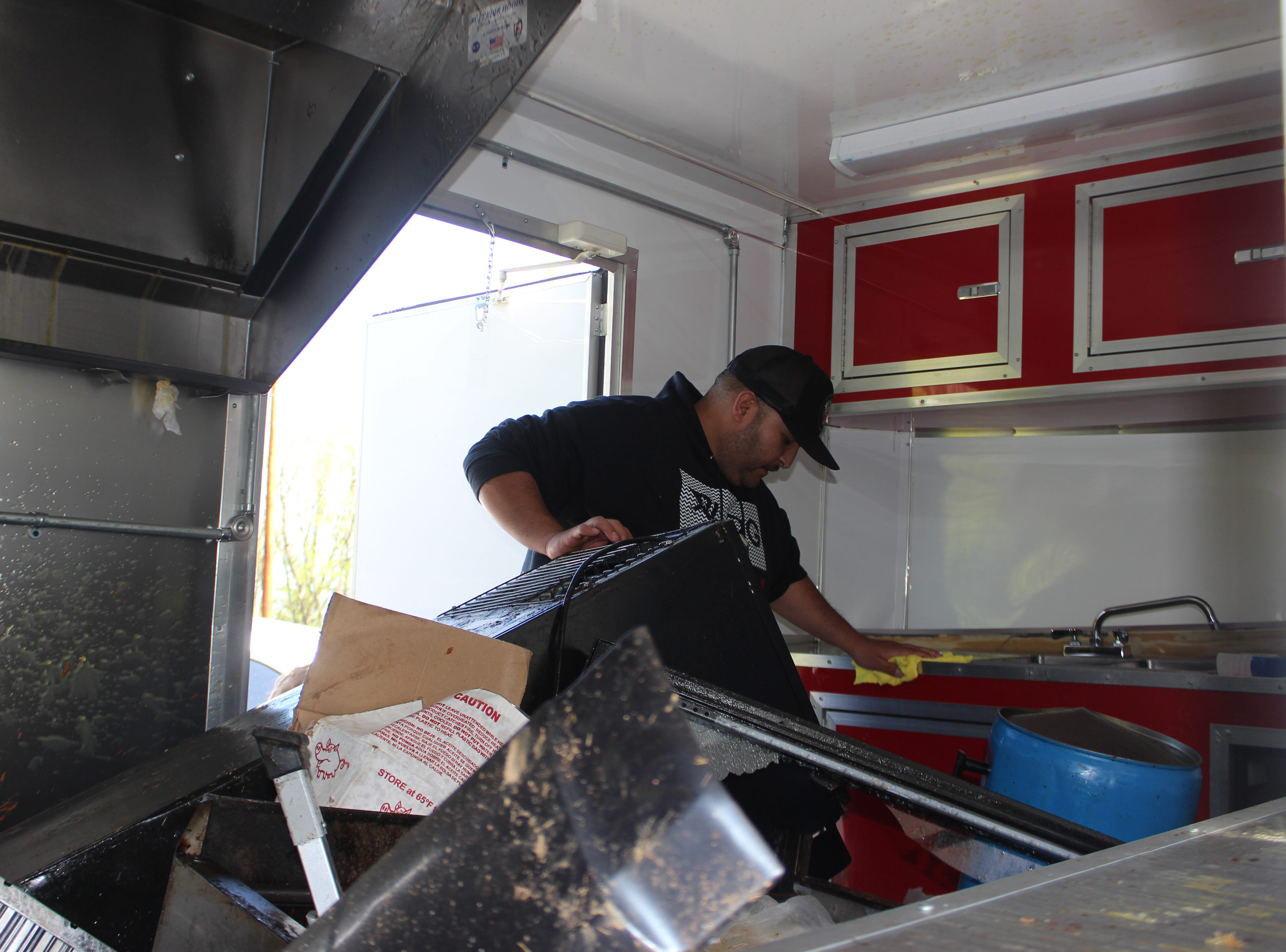 Adrian Gonzalez of Clarksville inspects the damage to his Fatboy Tacos trailer after it was totaled in a wreck Saturday, April 13, 2019.