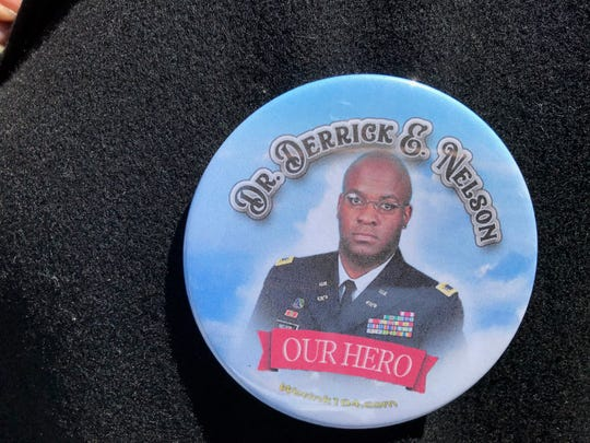 The pin worn by several mourners at funeral for Westfield High School Principal Derrick Nelson