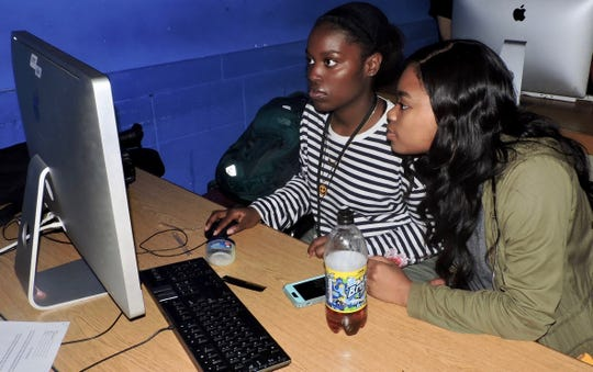 Courtney Theodule and Ariana Eastwood of Linden working on a video project they created with visiting students from Franklin High School.