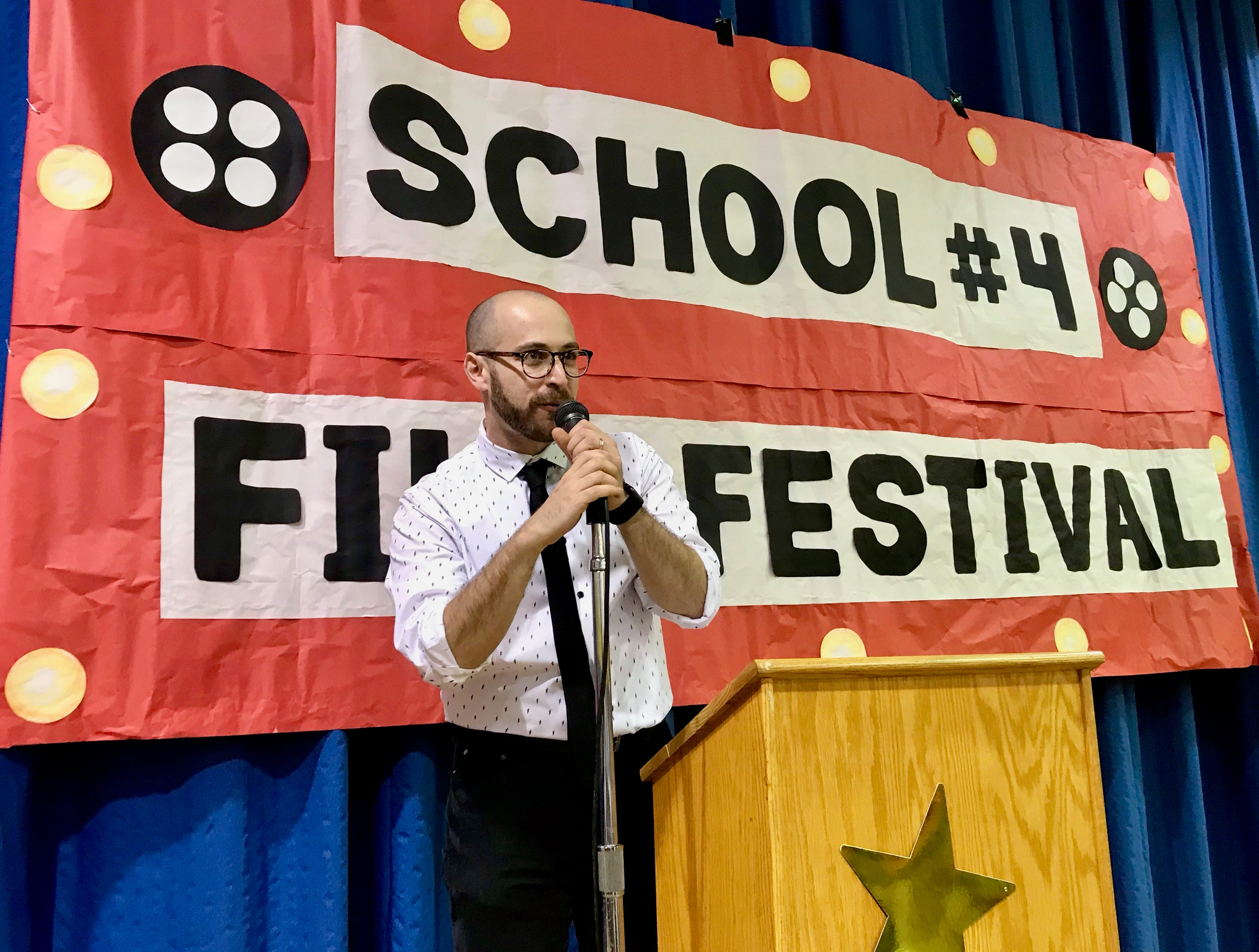 School No. 4 technology teacher Mitch Gorbunoff introducing winners at the school's inaugural film festival.