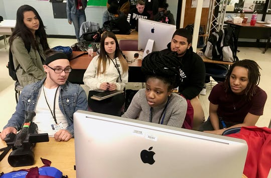 Students from Linden and Franklin high schools collaborating on editing and producing a video project during their joint master class in Linden on March 29. Front, from left, are Jeff Grant and Fatima Goba of Franklin, and Jasmine Odom of Linden. Back, from left, are Victoria Werner of Franklin, and Kristin Martins and Isiah Vargas of Linden.