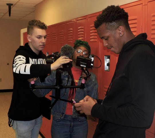 Students from Linden and Franklin high schools recording video for their joint project. From left are Brandon Fitzgerald of Franklin, and Shanique Boss and Amir Williams of Linden.