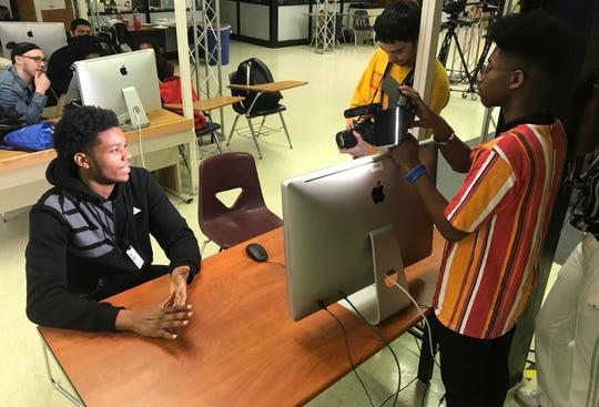 Jordan Bethea of Linden being recorded by Brandon Torres and Jakobe Anderson of Franklin.