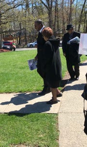 Westfield High School Principal Derrick Nelson's family members leave the church following the funeral