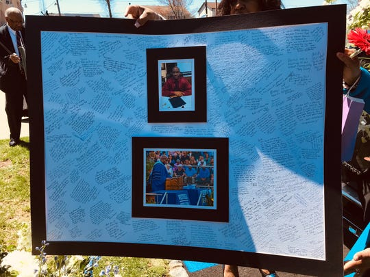 A poster featuring messages of condolence following the death of Westfield High School Principal Dr. Derrick Nelson.