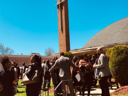 Mourners leave the funeral for Westfield High School Principal Dr. Derrick Nelson at St. John the Baptist Church in Scotch Plains.