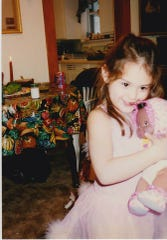 Jeanina Messerly plays with her doll as a child.