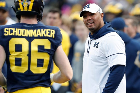 Michigan offensive coordinator Josh Gattis looks at tight end Luke Schoonmaker during the team's spring game on Saturday, April 13, 2019, in Ann Arbor.