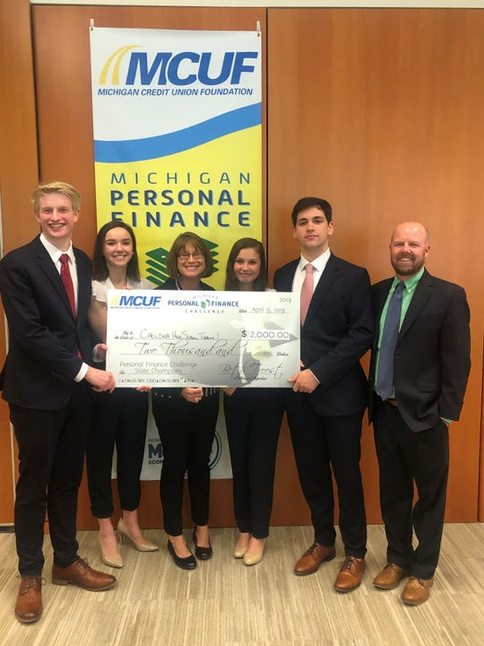 The winning Chelsea High School team in the 2019 Michigan Personal Finance Challenge. Left to right: Drew Vanderspool, 18; Carly O'Neil, 17; Beth Troost, Michigan Credit Union Foundation; Briana Hay,17; Jack Conlin, 18; and teacher Matt Pedlow.