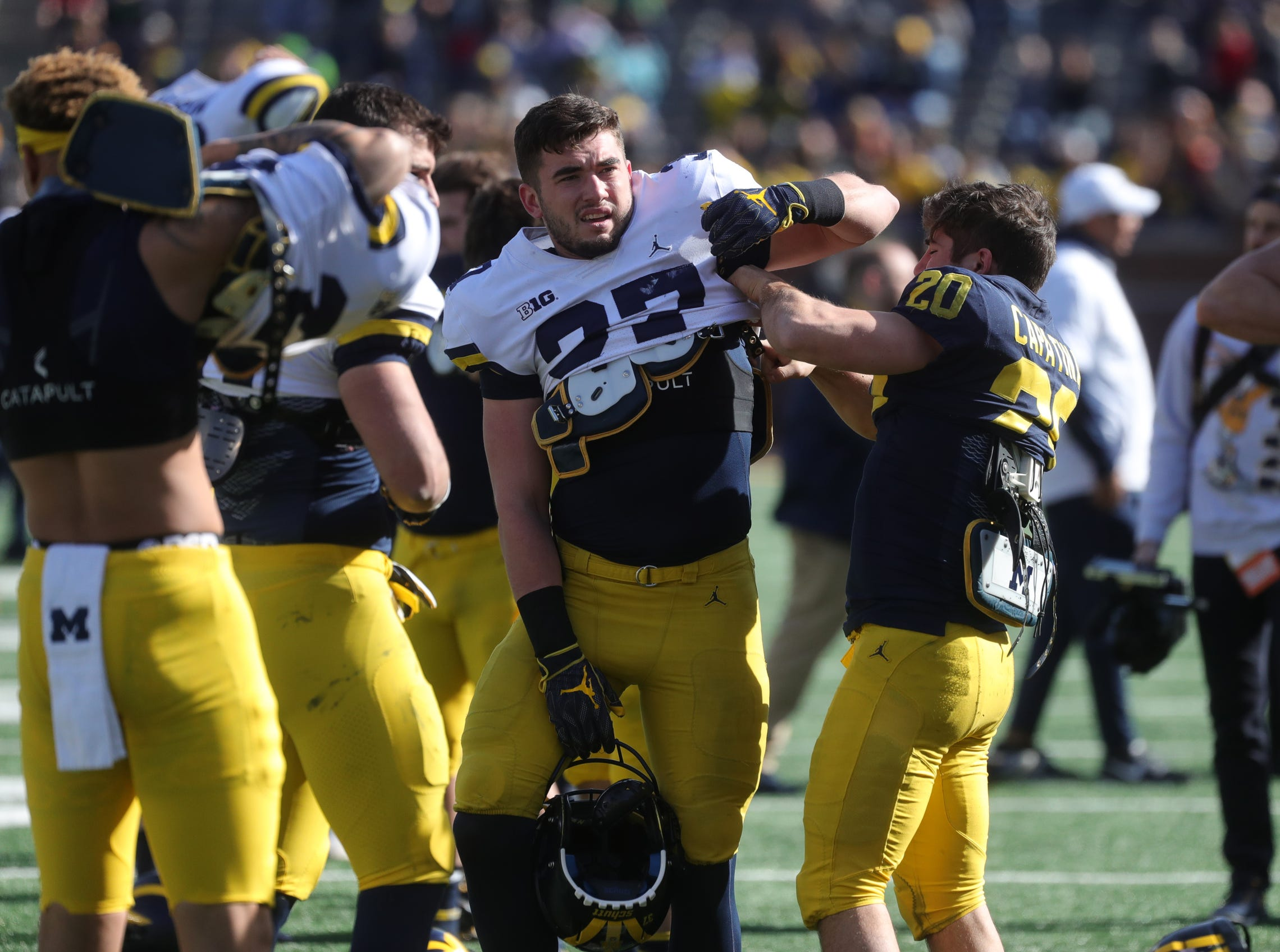 Michigan players put on pads before the spring game Saturday, April 13, 2019 at Michigan Stadium in Ann Arbor.