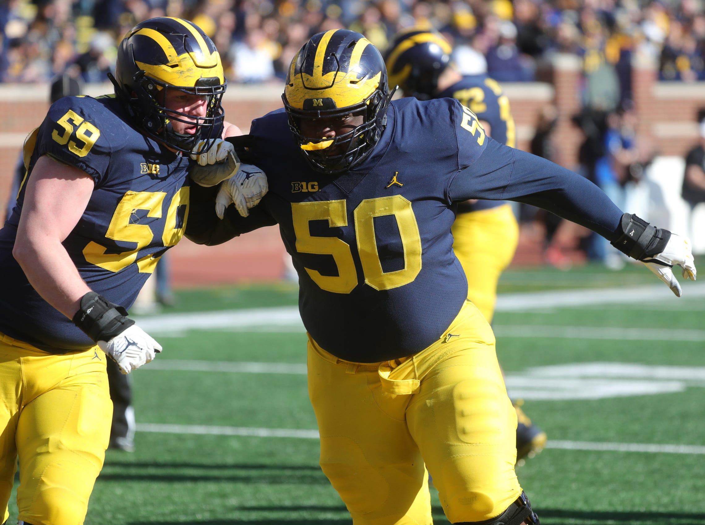 Michigan's Michael Onwenu and Joel Honigford at the spring game Saturday, April 13, 2019 at Michigan Stadium in Ann Arbor.