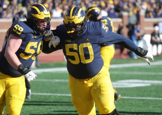 Michigan's Michael Onwenu and Joel Honigford at the spring game Saturday, April 13, 2019 at Michigan Stadium in Ann Arbor.
