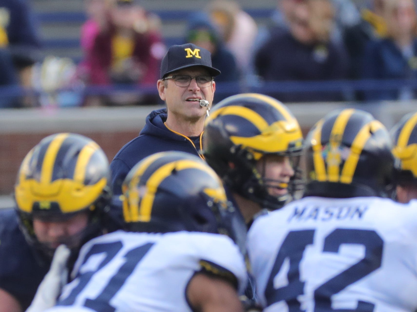 Michigan head coach Jim Harbaugh watches the action during the spring game Saturday, April 13, 2019 at Michigan Stadium in Ann Arbor.