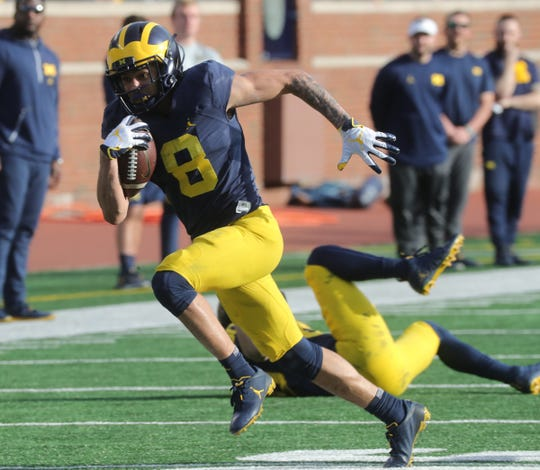 Michigan receiver Ronnie Bell makes a catch during the spring game Saturday, April 13, 2019 at Michigan Stadium in Ann Arbor.