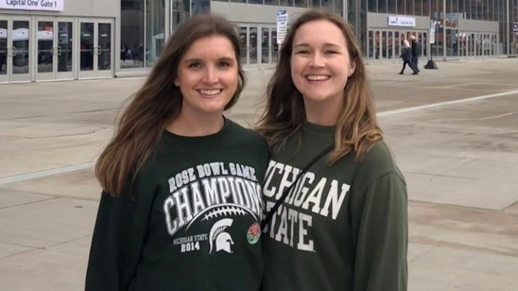 Kate Mahon (left) and her sister, Tara Mahon, cheered for Michigan State University at the Final Four NCAA basketball game in Minneapolis.