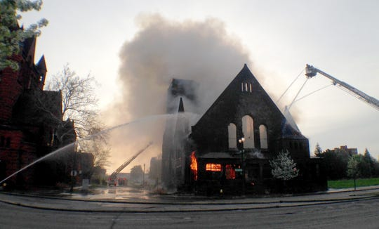 The vacant First Unitarian Church of Detroit is engulfed in flames as Detroit firefighters try to control the fire that broke out early Saturday morning, Mary 10, 2014. The historic landmark church was built in 1889 and had been vacant. Diane Weiss