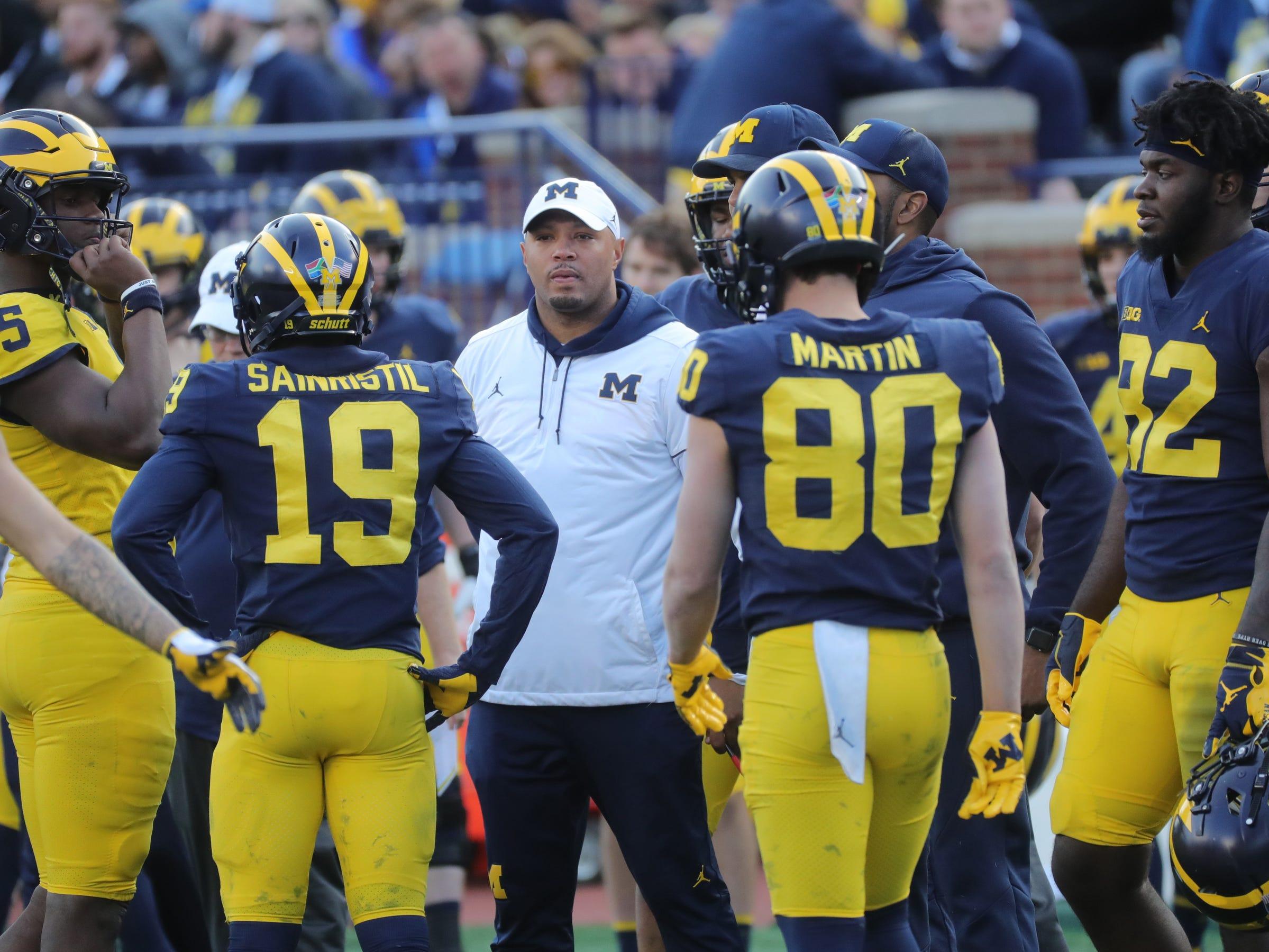 Michigan offensives coordinator Josh Gattis talks to the players during the spring game Saturday, April 13, 2019 at Michigan Stadium in Ann Arbor.