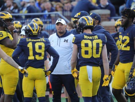 Michigan offensive coordinator Josh Gattis talks to the players during the spring game Saturday, April 13, 2019 at Michigan Stadium in Ann Arbor.