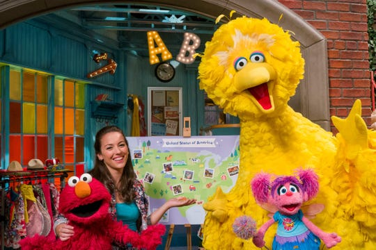 "Sesame Street's Nina helps Big Bird, Elmo, and Abby Cadabby plan their cross-country road trip."" (Photo credit-Richard Termine)"