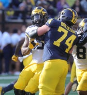Michigan offensive lineman Ben Bredeson blocks Kwity Paye during the spring game Saturday, April 13, 2019 at Michigan Stadium in Ann Arbor.