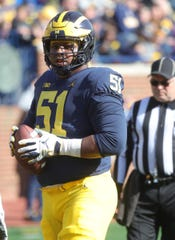 Michigan offensive lineman Cesar Ruiz lines up during the spring game Saturday, April 13, 2019 at Michigan Stadium in Ann Arbor.