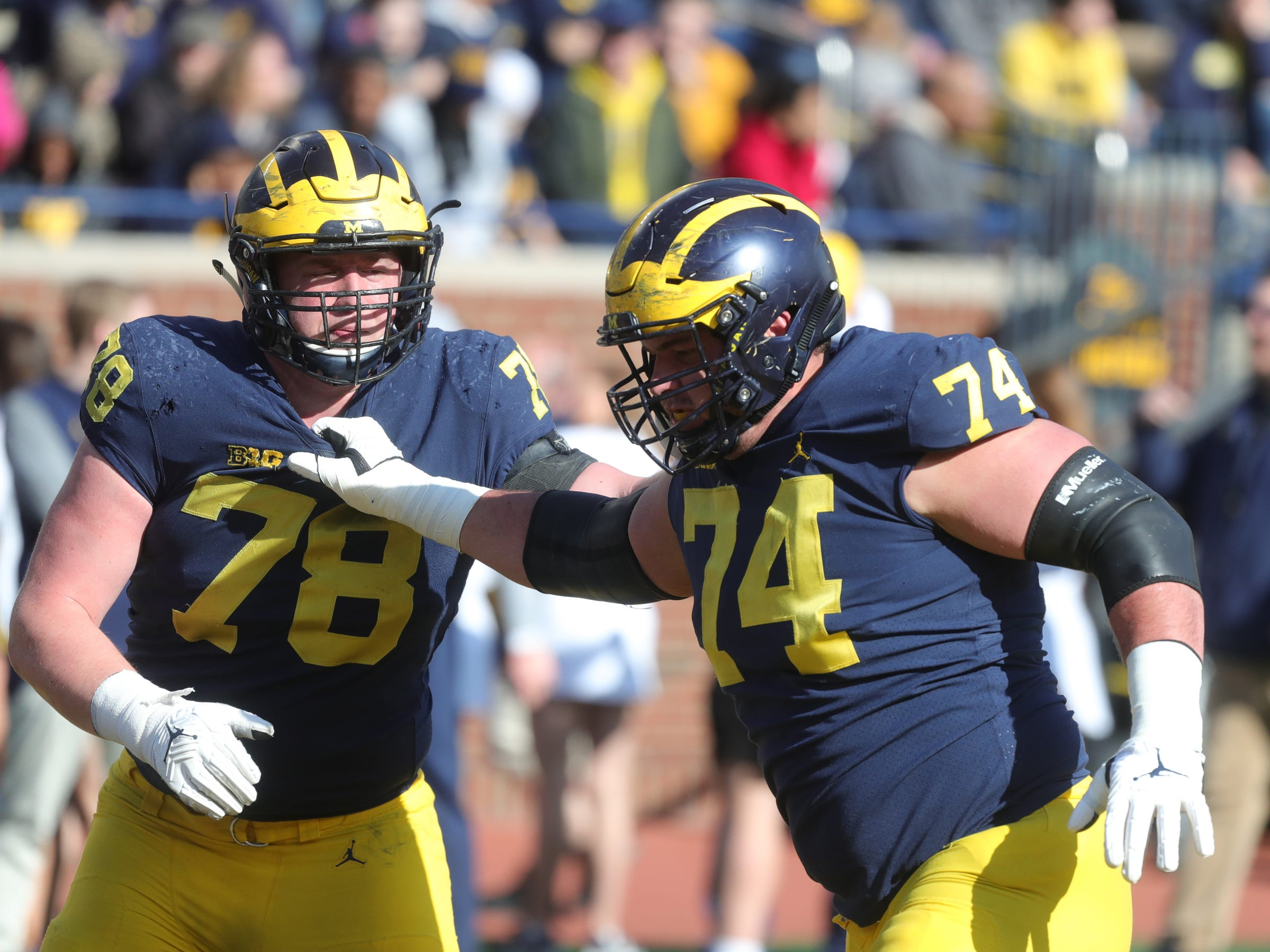 Michigan's Ben Bredeson, right, and Griffin Korican at the spring game Saturday, April 13, 2019 at Michigan Stadium in Ann Arbor.