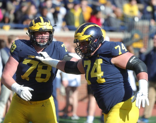 Michigan's Ben Bredeson, right, and Griffin Korican at the spring game.
