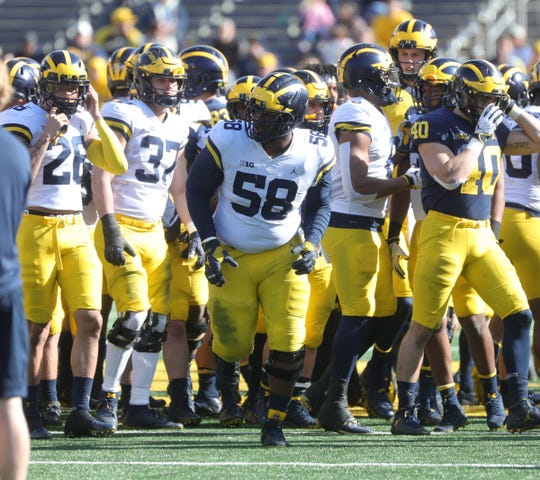 Michigan's Mazi Smith (58) takes the field for the spring game Saturday, April 13, 2019 at Michigan Stadium in Ann Arbor.