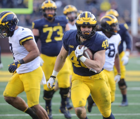 Michigan running back Ben VanSumeren runs the ball during the spring game Saturday, April 13, 2019 at Michigan Stadium in Ann Arbor.