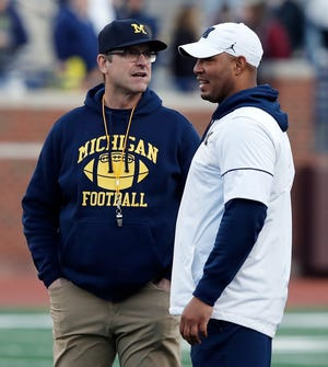 Michigan coach Jim Harbaugh, left, and offensive coordinator Josh Gattis talk during the team's spring game on Saturday, April 13, 2019, in Ann Arbor.