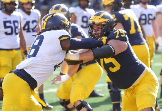 Michigan's Jon Runyan blocks Luiji Vilain during the spring game Saturday, April 13, 2019 at Michigan Stadium in Ann Arbor.