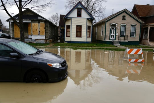 Water begins to recede on Wabash Street in the Corktown neighborhood of Detroit after a water main break on Tuesday, April 16, 2019.