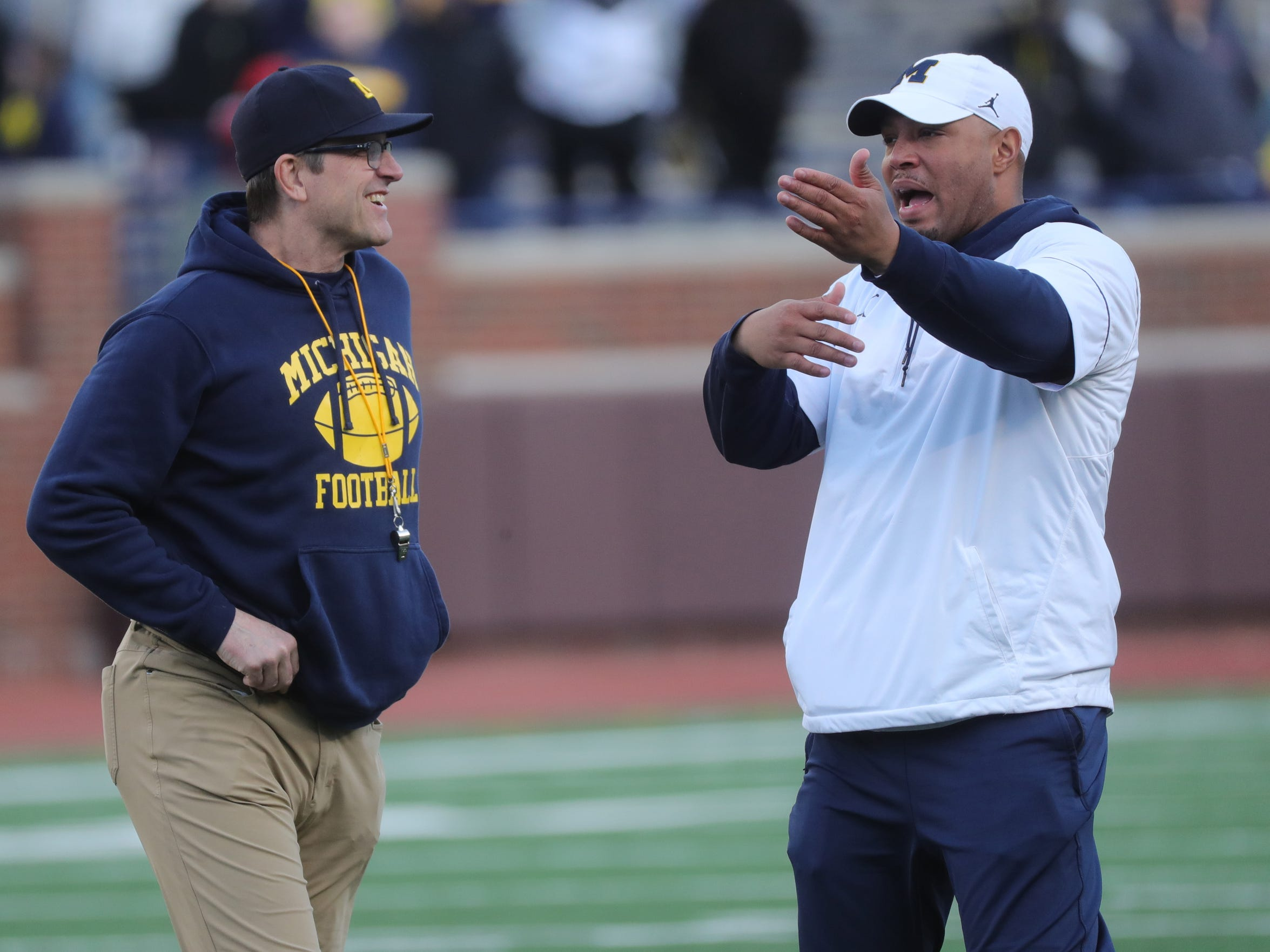 Michigan head coach Jim Harbaugh and offensive coordinator Josh Gattis during the spring game Saturday, April 13, 2019 at Michigan Stadium in Ann Arbor.