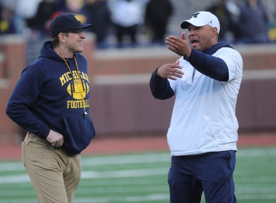 Michigan head coach Jim Harbaugh and offensive coordinator Josh Gattis during the spring game Saturday, April 13, 2019 at Michigan Stadium in Ann Arbor.