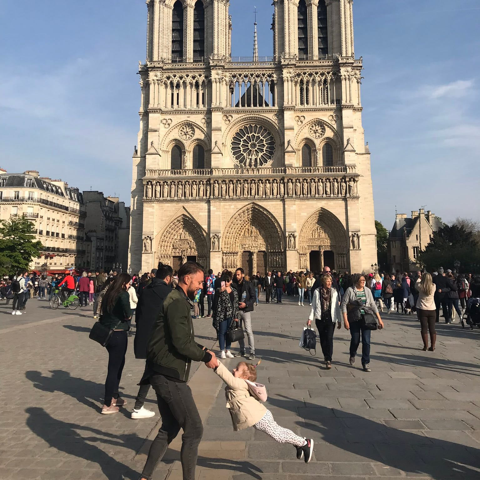 Michigan woman snapped photo of mystery man, child just before Notre Dame fire