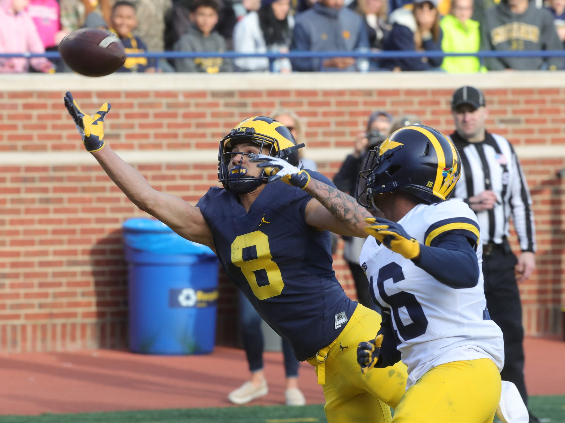 Michigan receiver Ronnie Bell tries to make a catch against defensive back Jaylen Kelly-Powell during the spring game Saturday, April 13, 2019 at Michigan Stadium in Ann Arbor.