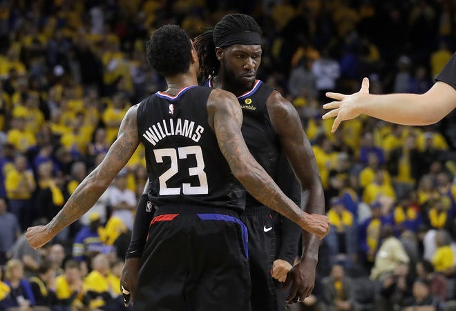 Los Angeles Clippers guard Lou Williams (23) celebrates with forward Montrezl Harrell during the second half on Monday.