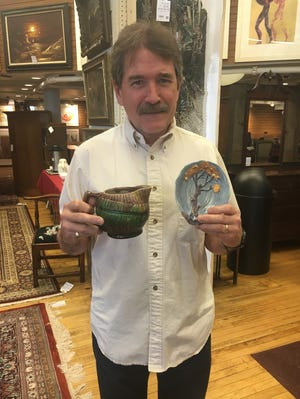 """It's an example of a kind of pottery called Carlton Ware,"" Bob DuMouchelle recently told Gerry McCarroll, pictured, about the item he brought in."
