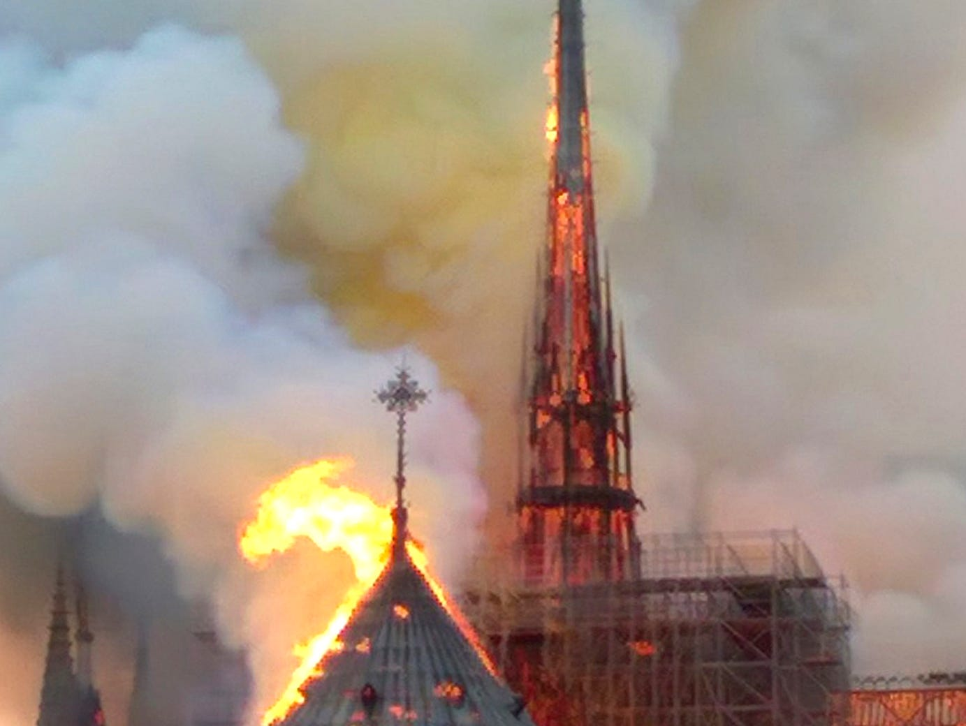 The spire and parts of Notre Dame cathedral is on fire in Paris, Monday, April 15, 2019. A catastrophic fire engulfed the upper reaches of Paris' soaring Notre Dame Cathedral as it was undergoing renovations Monday, threatening one of the greatest architectural treasures of the Western world as tourists and Parisians looked on aghast from the streets below.
