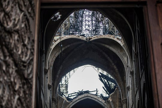 Holes in the dome inside the damaged Notre Dame cathedral in Paris, Tuesday, April 16, 2019.