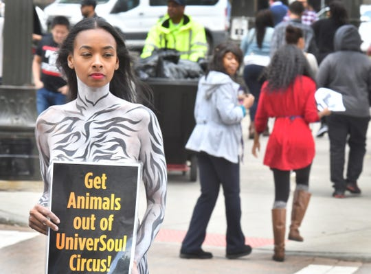 Nikki Ford, 31, of PETA protests the opening night performance of 'UniverSoul Circus' Thursday and their use of animals in their performances by wearing zebra body paint, and not much else, at lunch hour in Campus Martius in Detroit, Michigan on September 7, 2017.
